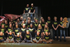 Group photo of cast members on stage; all wearing Shrek The Musical t-shirts.
