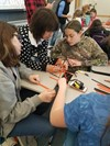 """ACS students collaborating at the """"Women Helping Girls"""" field trip."""