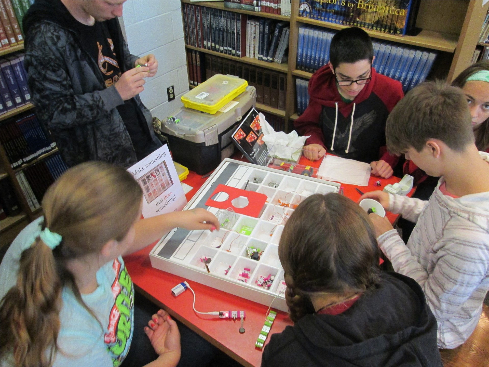 Several students experimenting with building littleBits electric devices.