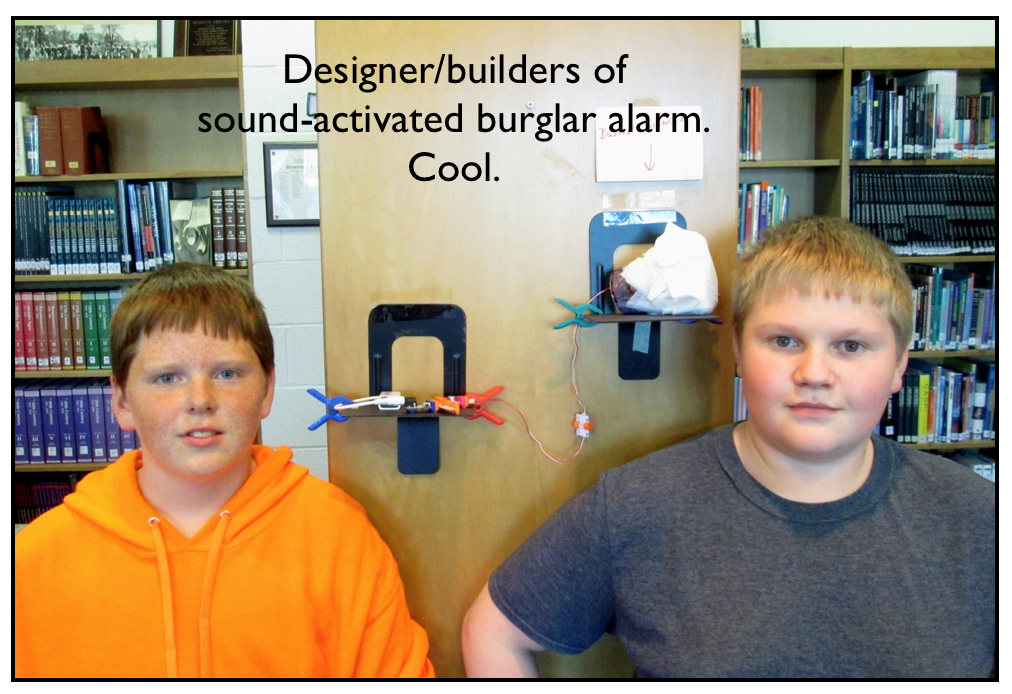 Image of two students and their sound-activated burglar alrm.