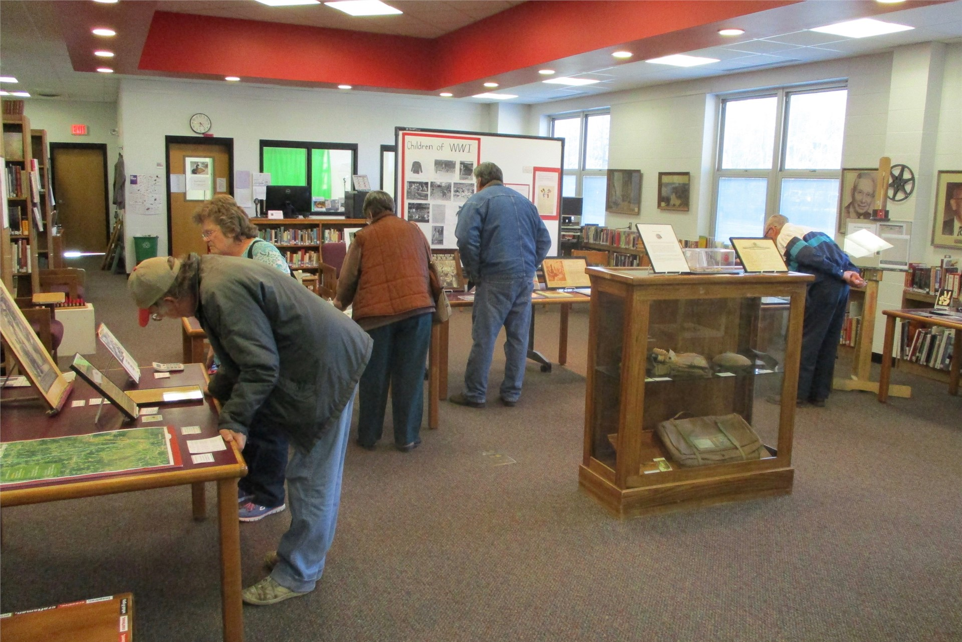 World War I exhibit: visitors looking at displays.