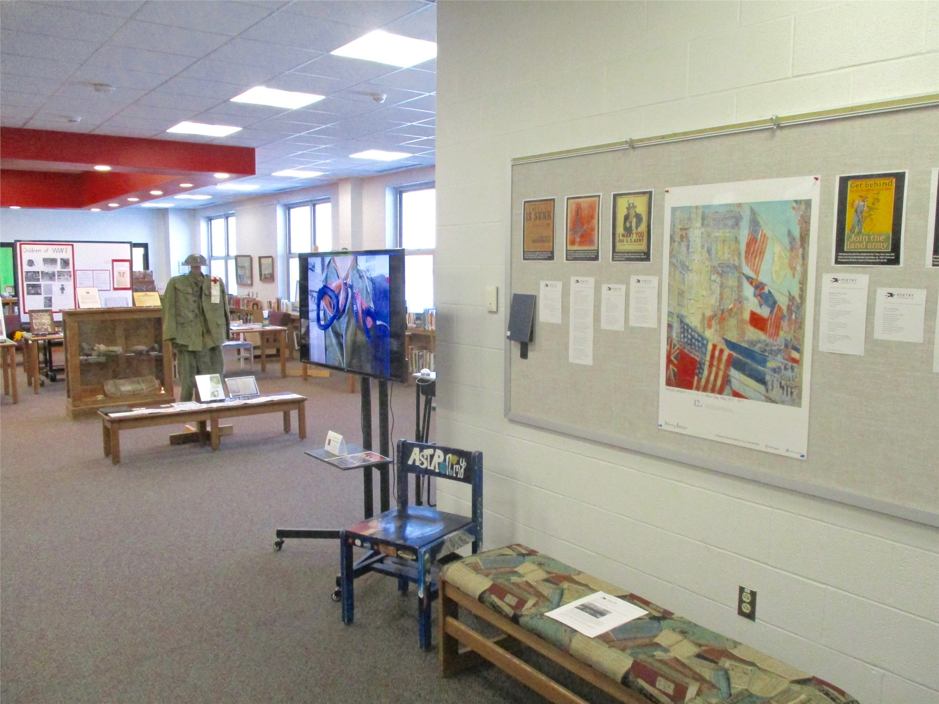 World War I exhibit: shelf display of period magazine illustrations.