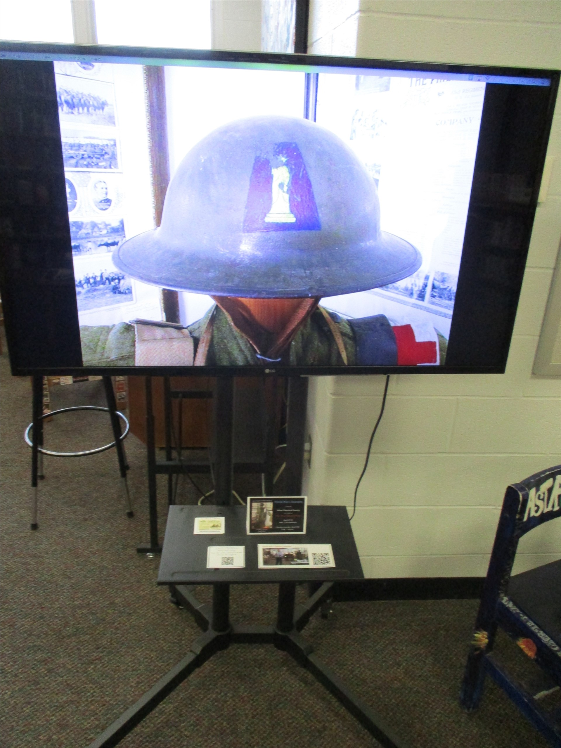World War I exhibit: image of large screen slideshow display.