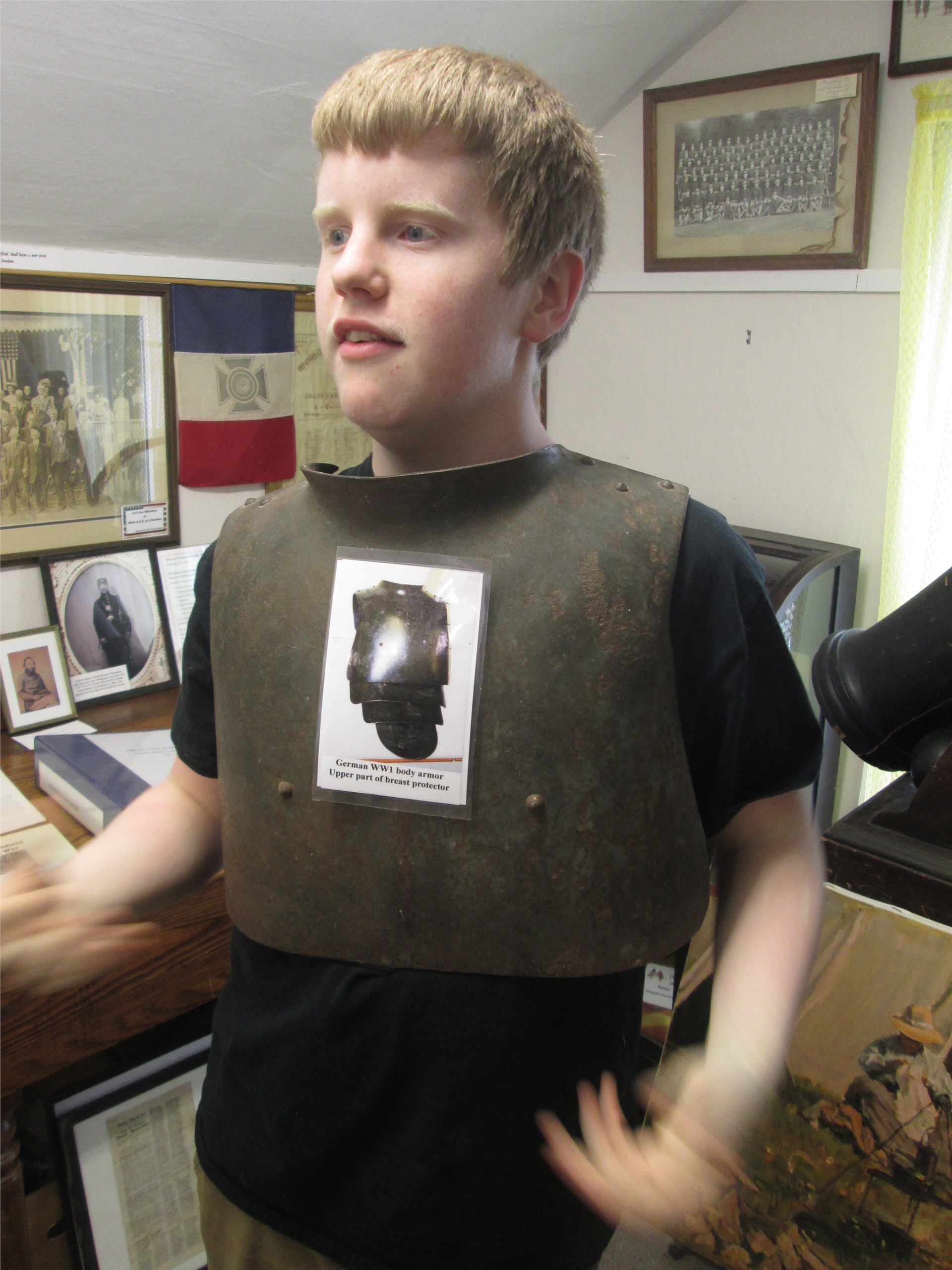 World War I exhibit: Exhibit planner wearing artillery armor.