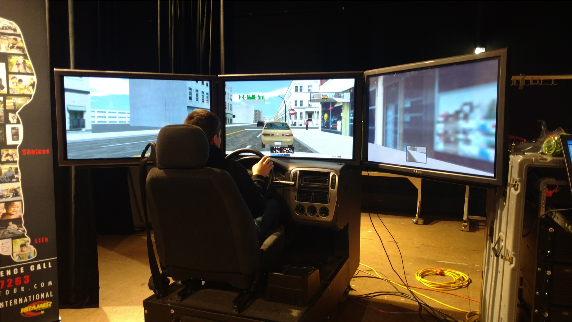 Student at console of virtual driving simulator.