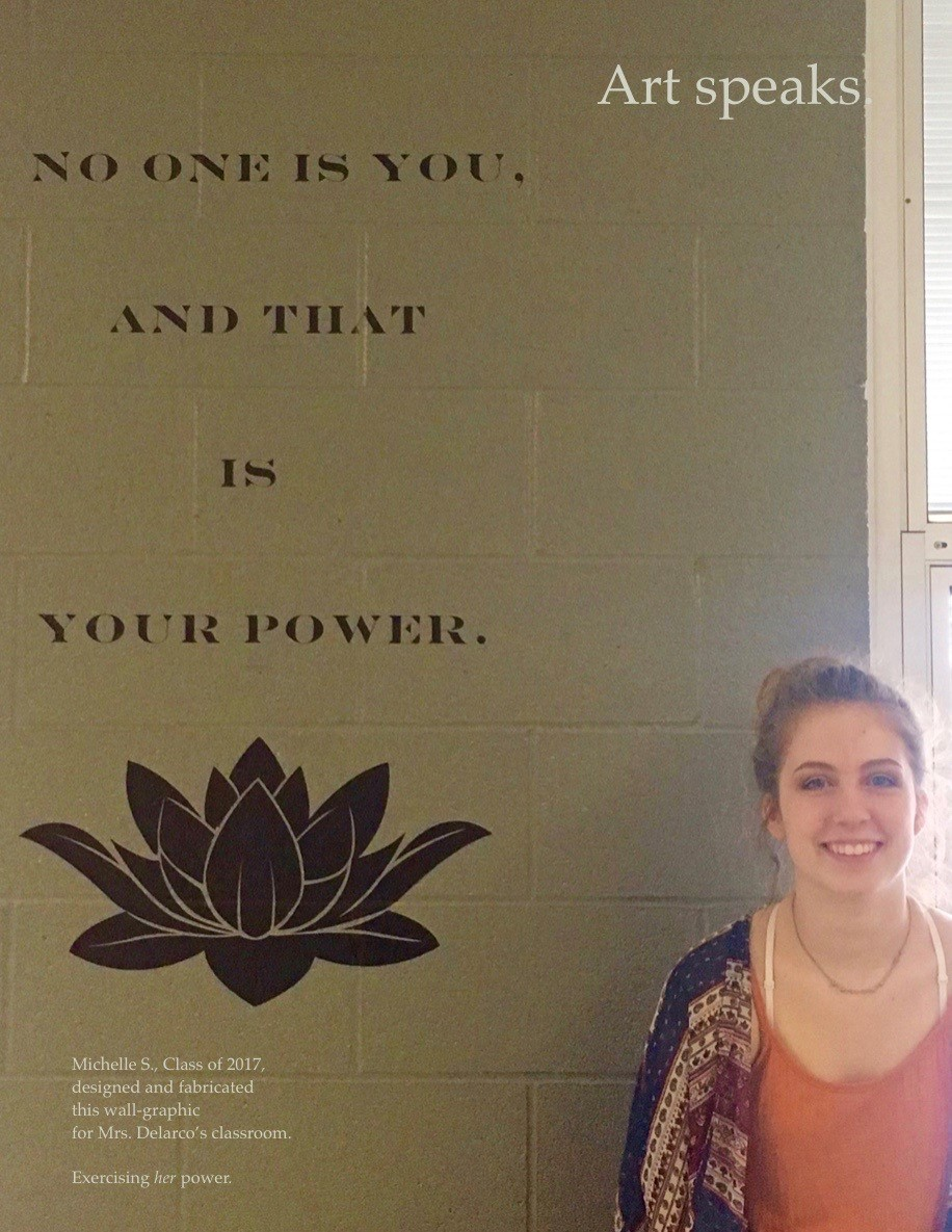 ACSLIB Poster: Student standing next to her classroom mural quotation.