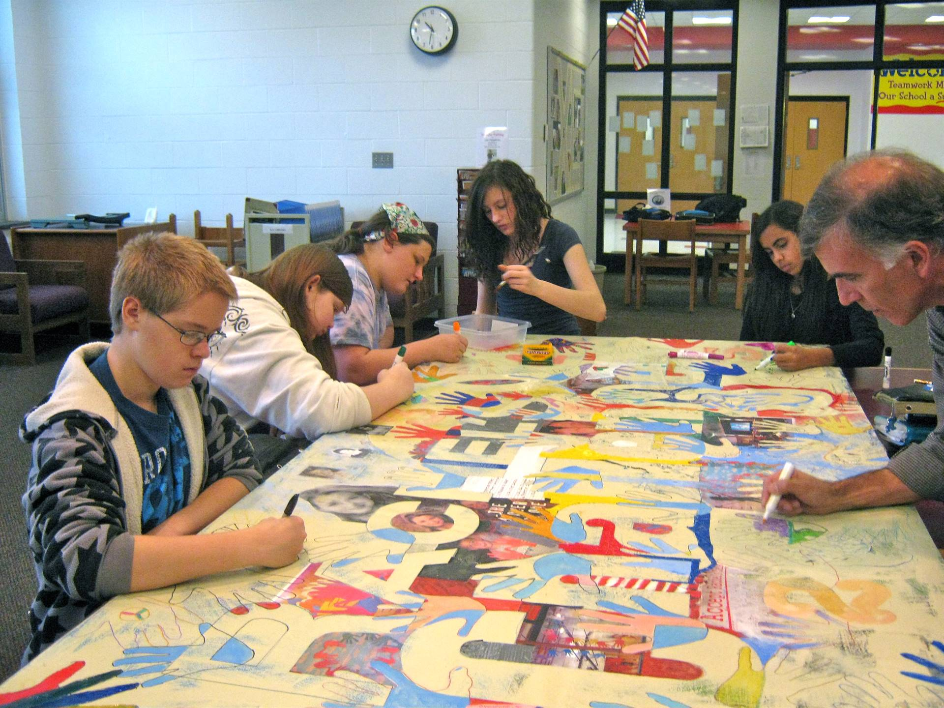 Library group creating Rachel's Challenge 4' x8' painting.