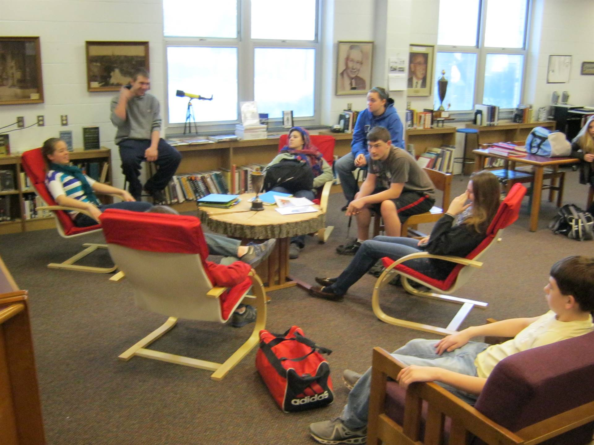 """Library seating. """"Table"""" made from slab of historic school tree."""
