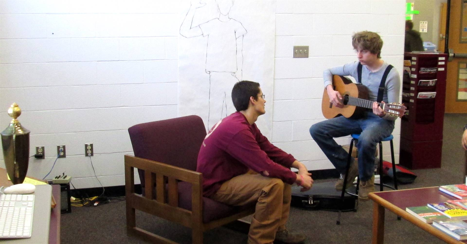 Student guitarists in library commons.