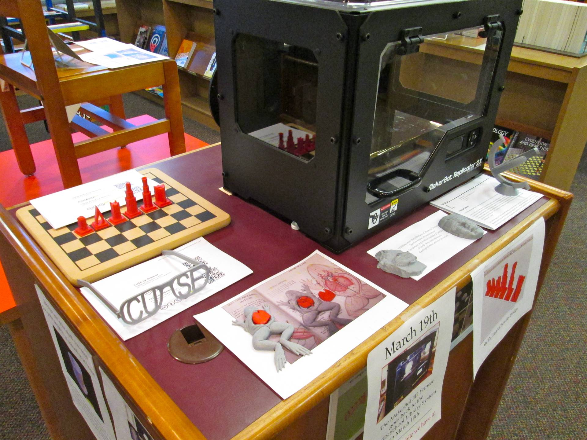 BOCES SLS 3D printer with Afton projects on display.