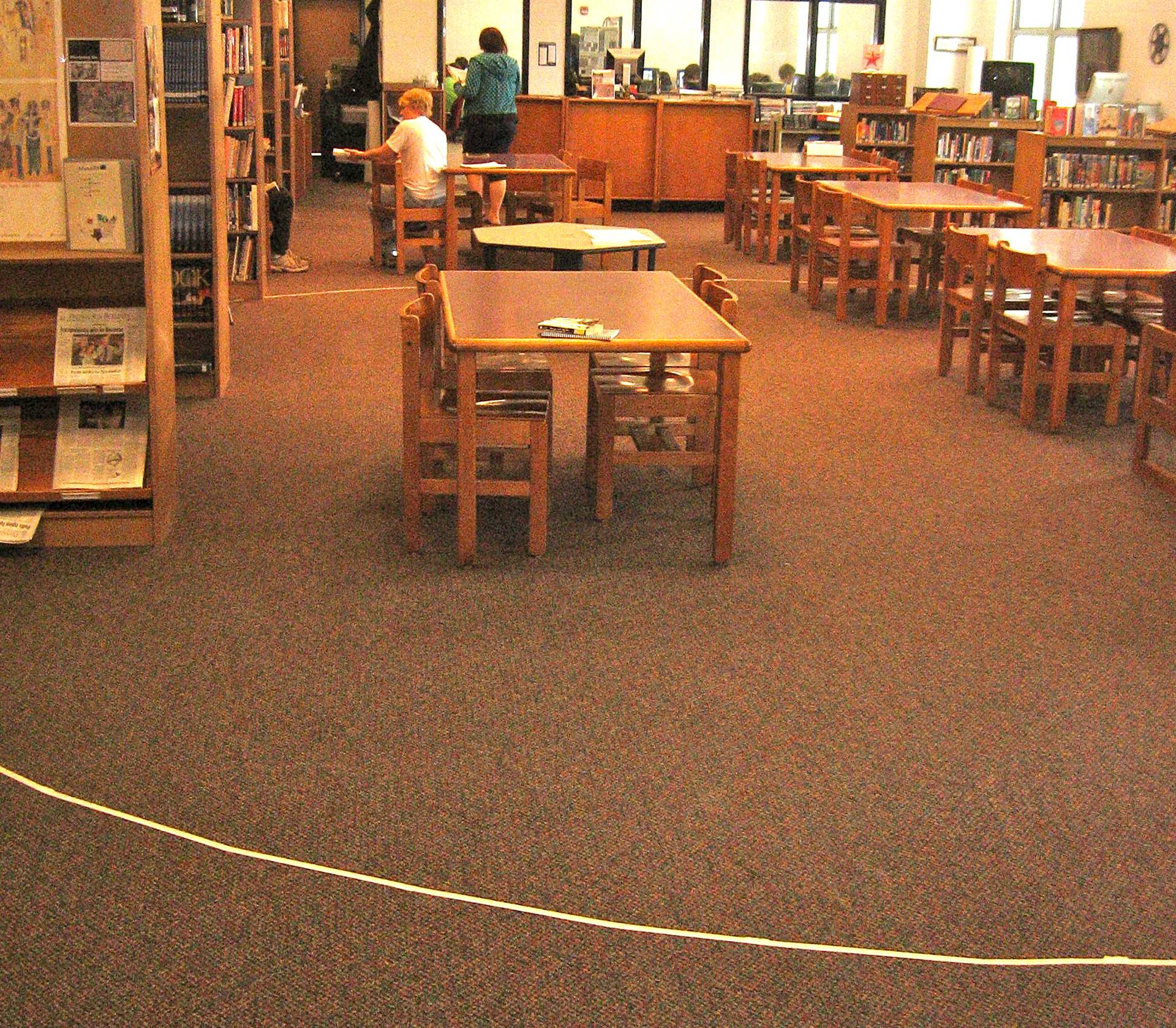Tape on the floor inllistrating the circumference of largest redwood tree.