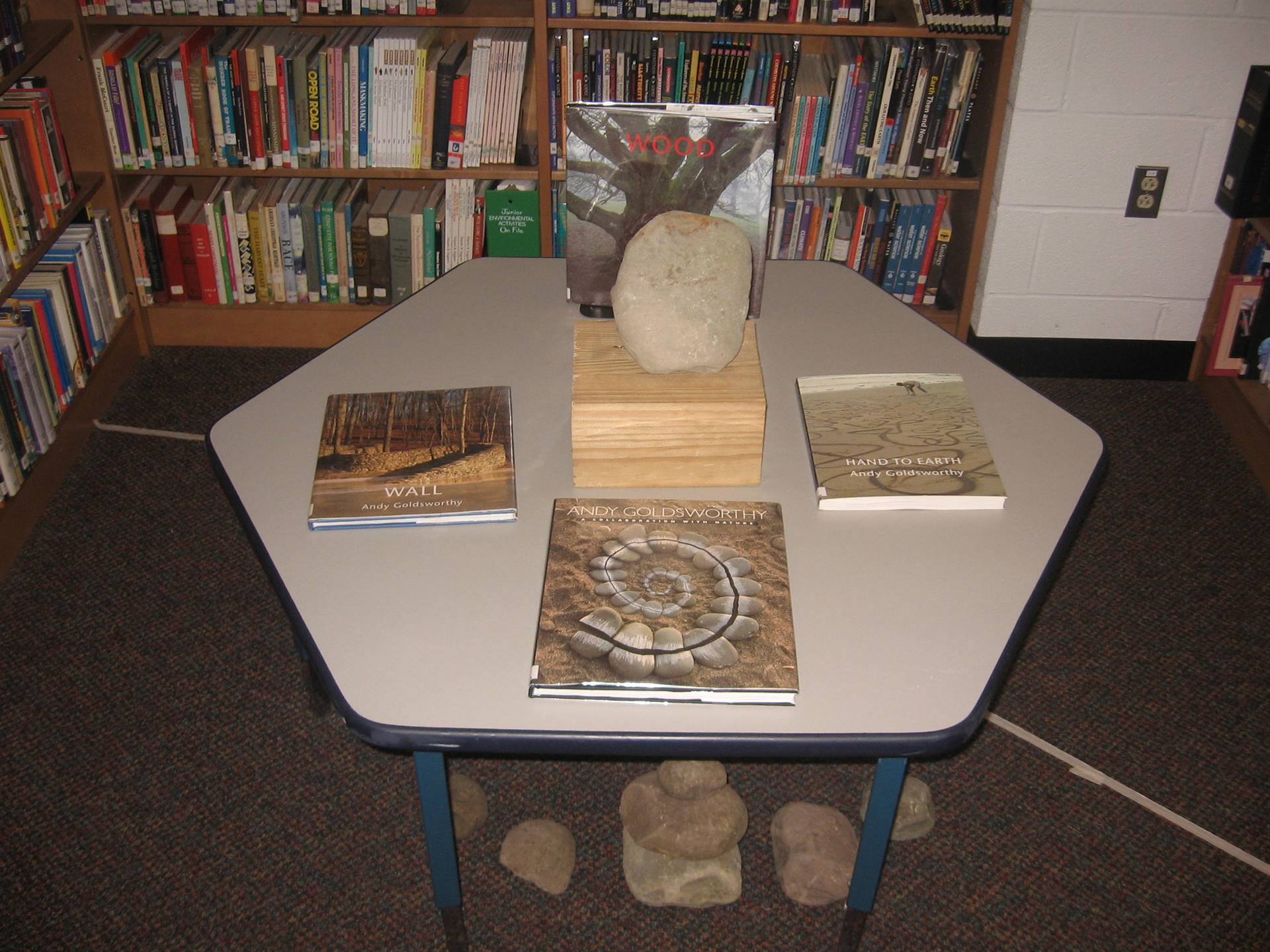 Book display with rock: the works of Andy Goldsworty.
