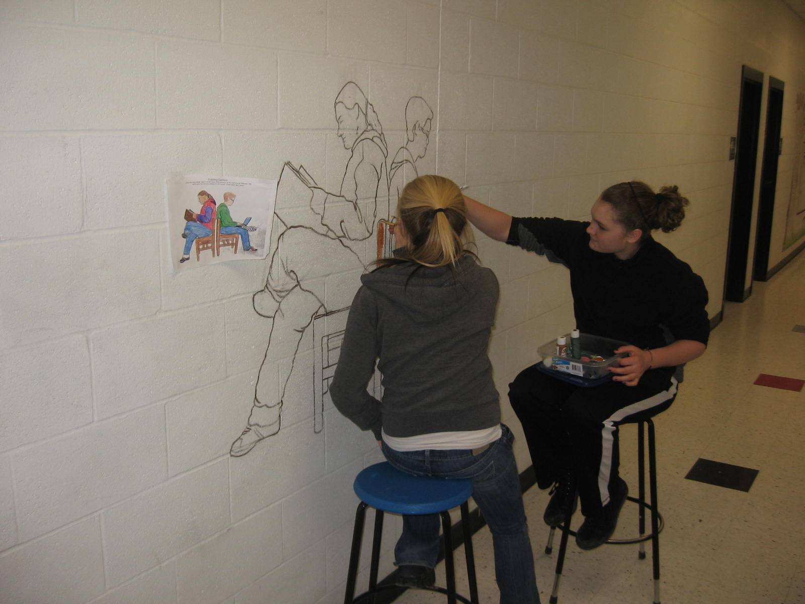 Creating library mural.