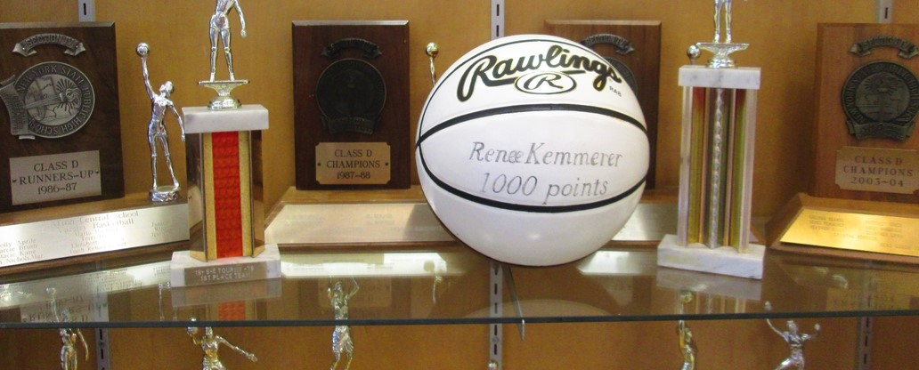 Basketball trophy case featuring 1000 point basketball.