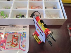 Image of student LEGO project with littleBits in background.